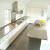 27 foot L-shaped stainless counter, seamless with integral backsplash.